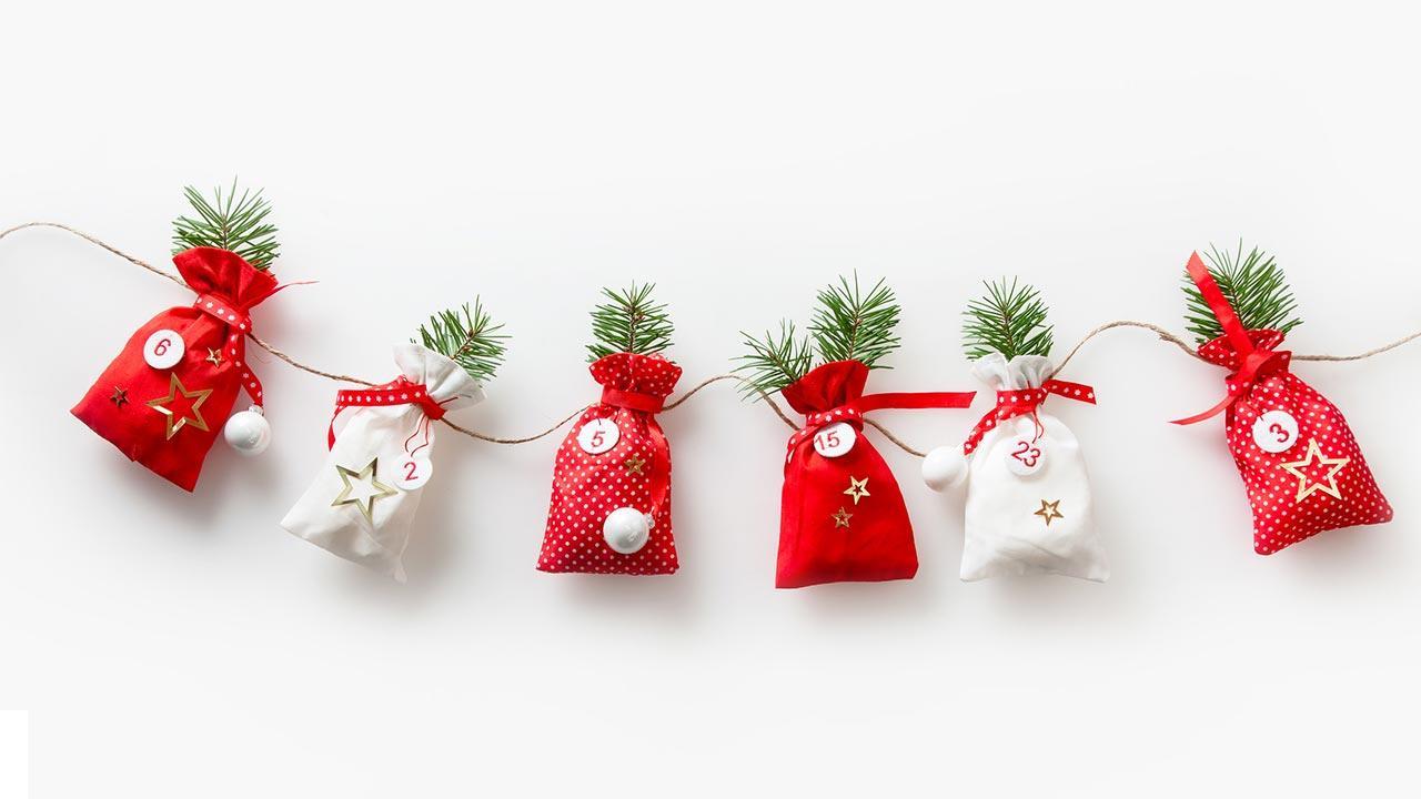 Adventskalender kaufen oder selber basteln - in Stoffsäckchen